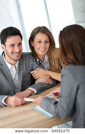 Couple meeting financial adviser for construction project