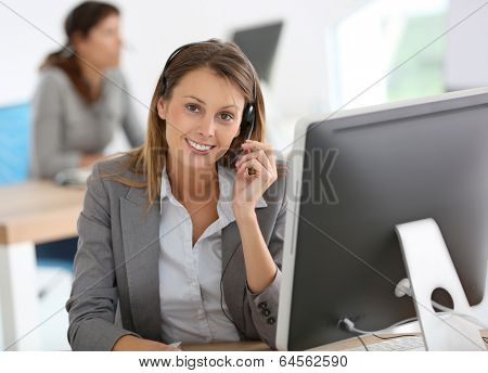 Smiling customer service representative at work