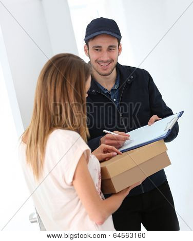 Delivery man having customer signing proof of delivery