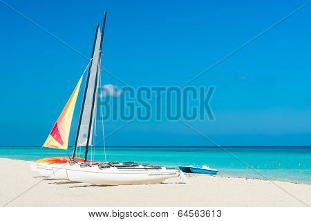 Colorful sailing boats for rent on a sunny day at Varadero beach in Cuba