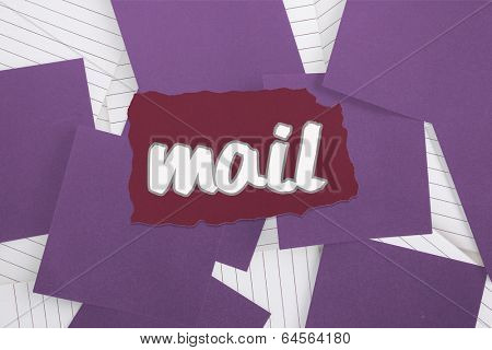The word mail against purple paper strewn over notepad