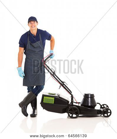 happy gardener standing next to a lawnmower isolated on white