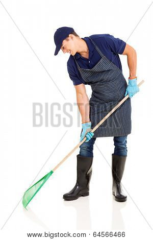 professional young gardener raking on white background