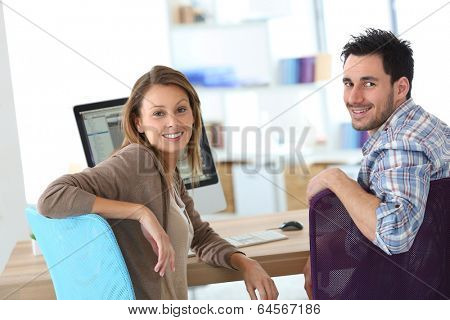 Business people meeting in front of desktop