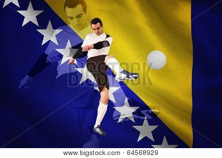 Football player in white kicking against digitally generated bosnian flag