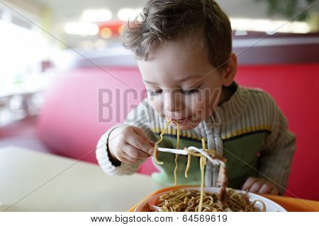 Kid Eating Spaghetti