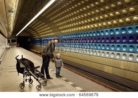 Portrait Of Family At Subway Station