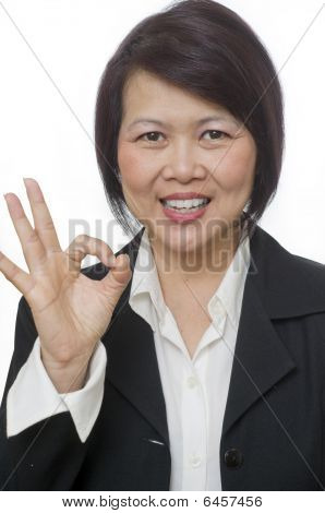 Woman Making Ok Hand Sign