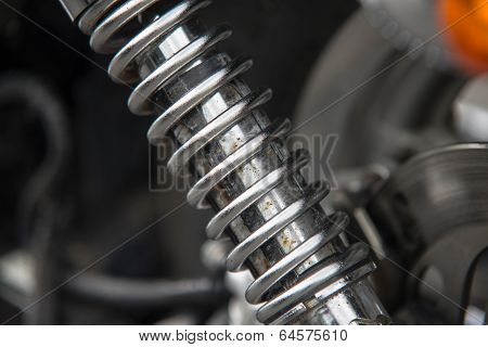 Close Up Of Rusty Chrome Motorcycle Shock Absorber