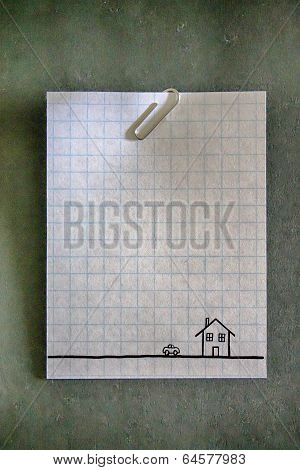 Paperclip On An Empty White Grid Paper