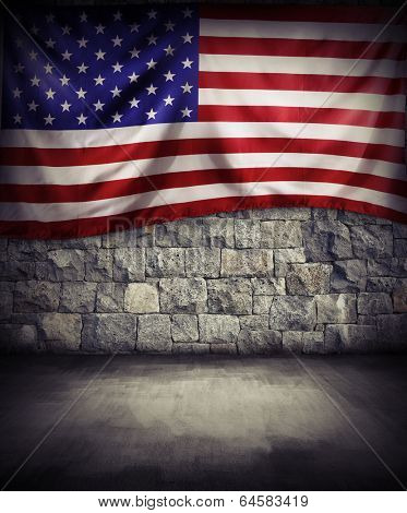 American flag on rock wall