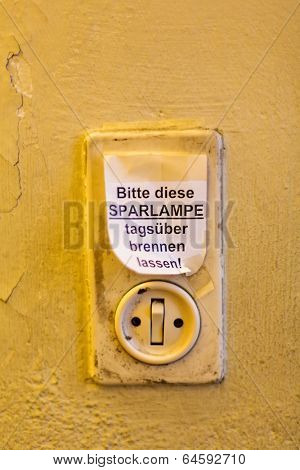 old light switch with label, let it burn saving lamp daytime