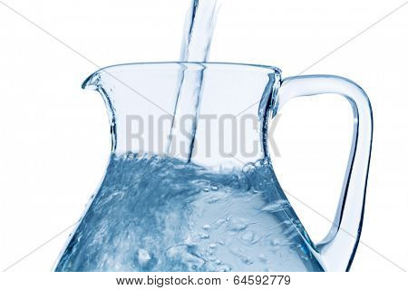 pour water in a carafe, symbol photo for drinking water, refreshment, demand and consumption