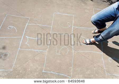 Playing In Hopscotch Outdoors