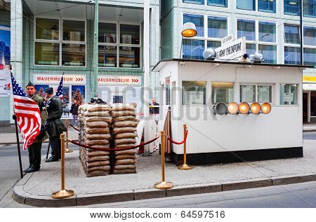 BERLIN, GERMANY-APRIL 18: Checkpoint Charlie on April 18, 2014. It's the best-known Berlin Wall crossing point between East Berlin and West Berlin during the Cold War.