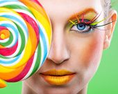 stock photo of lollipop  - Colorful twisted lollipop colorful fashion makeup  - JPG