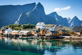 picture of lofoten  - Typical Norwegian fishing village with traditional red rorbu huts Reine Lofoten Islands Norway - JPG