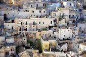 "foto of sassy  - Matera (Southern Italy) famous for its ancient town ""Sassi di Matera"" (meaning stones of Matera). Matera Italy - April 23 2013.