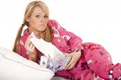 foto of tissue box  - a woman in her pink pajamas holding on to her box of tissues looking sad - JPG