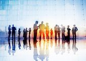 stock photo of conversation  - Silhouettes of Business People Discussing Outdoors - JPG