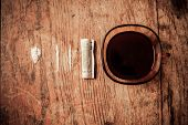 image of crack cocaine  - A cup of coffee with lines of cocaine and a rolled up banknote next to it - JPG