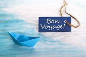 image of bon voyage  - A Blue Label with Bon Voyage which means Safe Trip at the Beach with a Boat - JPG