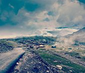 foto of himachal  - Vintage retro effect filtered hipster style travel image of Road in Himalayas on top of  Rohtang La pass - JPG