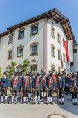 stock photo of ascension  - OBERPERFUSS AUSTRIA - AUG 15: Villagers dressed in their finest traditional costumes during Maria Ascension procession along this village near Innsbruck on Aug 15 2013 in Oberperfuss Austria.