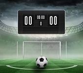 image of football pitch  - Black scoreboard with no score and football against football pitch in large stadium - JPG