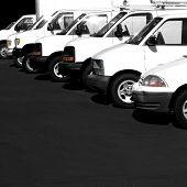 pic of car carrier  - Several cars vans and trucks parked in parking lot for sale - JPG
