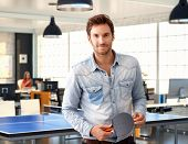 stock photo of ping pong  - Casual man holding ping - JPG