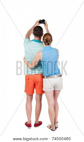 Back view of couple photographing. Tourists take pictures of the family together. Rear view people collection.  backside view of person. Isolated over white background.