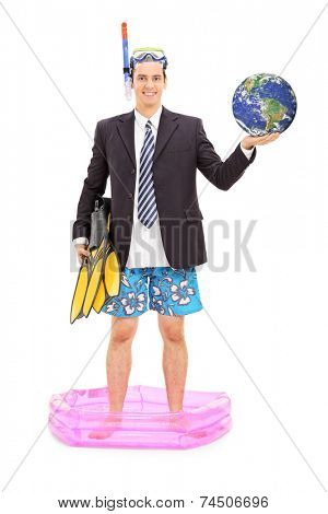Full length portrait of a businessman with diving mask holding the earth and standing in a small pool isolated on white background, Earth image in Public Domain and furnished by NASA