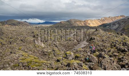 Tourists in Landmannalaugar unbelievable lava landscape, Iceland
