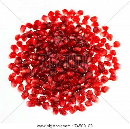 Red Pomegranate  Seeds In A Round Pile Isolated On White