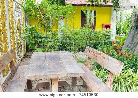 The Old Wooden Table And Chair In The Garden