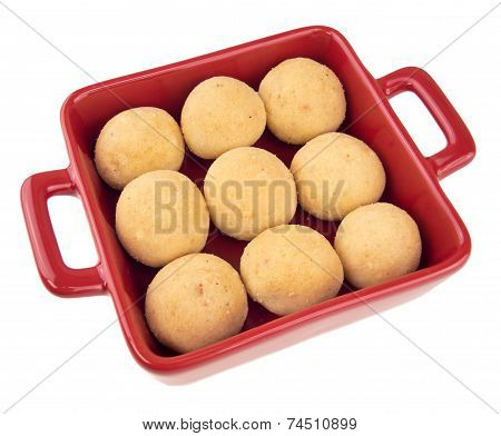 Indian Laddu Sweets In A Red Dish Isolated On White