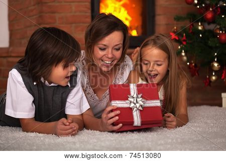 Family opening the presents at Christmas time