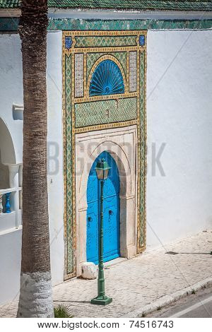 Blue Door With Black Studs And Stone Ornament At Doorway In Tunisia