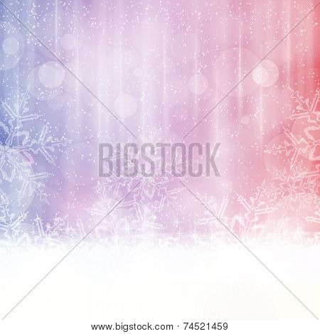 Abstract winter background in shades of blue, red and purple tones. Light effects, snowfall big snow flakes give it a dreamy and festive winter Christmas feel. Space for your text.