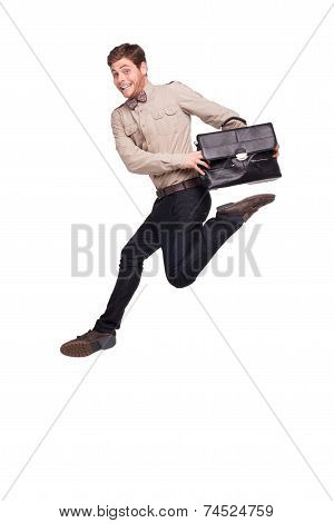 Smiling businessman jumping with briefcase
