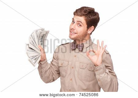 Happy young man with soft money