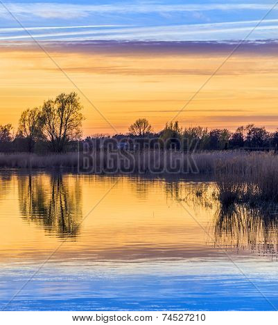 Sunset In Zinnowitz With Reflection On The Water