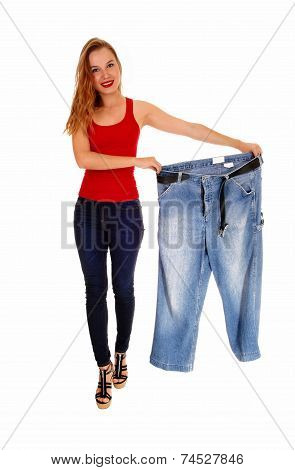 Woman Holding Big Pants.