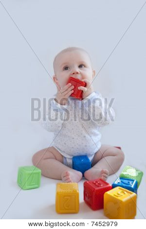 The Baby Plays With The Multi-coloured Cubes
