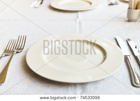 White Empty Plate On Table