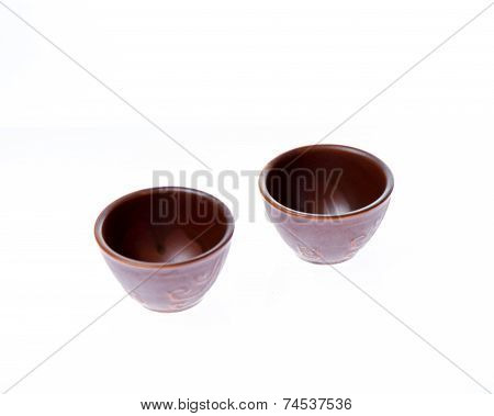 Two Small Sake Or Soju Glasses On White Background