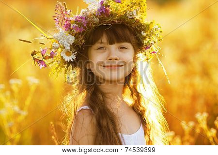 Happy Cute Girl Wearing A Wreath Of Flowers