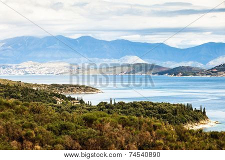 A view of the coastline of north-east Corfu, Greece, with the Albanian mountains across the strait.