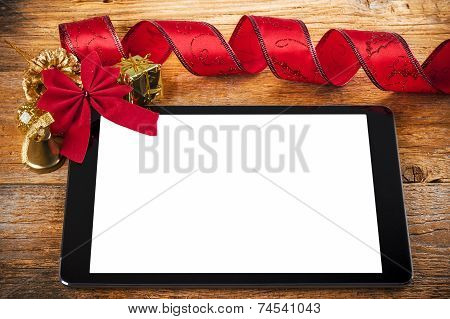 Tablet Pc with Christmas Decorations on Woodo